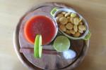 Aperitivo principesco: Succo di pomodoro condito con lime appena spremuto, sale integrale e pepe... E lupini da un euro l'etto!